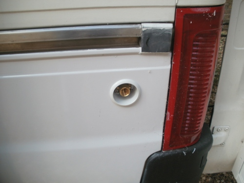 Yes, Perfectly lined up with hole in inside skin of van.